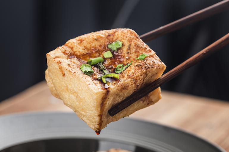 tofu with chopsticks